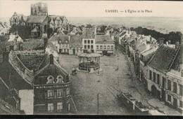 Cpa   CASSEL.   L'Eglise Et La Place, Avec KIOSQUE - Cassel
