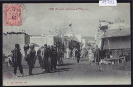 Tunisie - Béja : Entrée De La Ville Arabe - Petits Marchands, Char à Grande Roues - En 1906 (12´792) - Tunisie