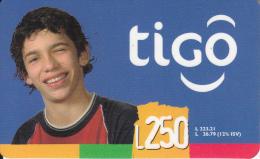 HONDURAS - Boy, TIGO Prepaid Card L250, Exp.date 12/06, Used - Honduras