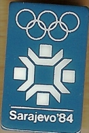 1984 Sarajevo White On Blue Olympic Games Mark Pin - Olympic Games
