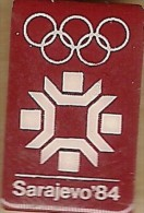 1984 Sarajevo White On Maroon Olympic Games Mark Pin - Olympic Games