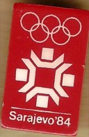 1984 Sarajevo White On Red Olympic Games Mark Pin - Olympic Games