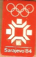 1984 Sarajevo White On Orange Olympic Games Mark Pin - Olympic Games