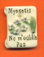 Feve  Faience - Fleur Myosotis - Sorpresine