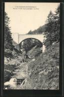 CPA Le Lioran, Le Pont Vom Flussufer Aus - Non Classés