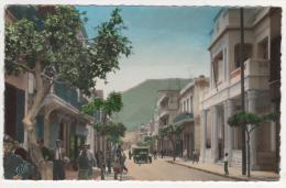 @ CPSM ANIMEE COLORISEE MERS EL KEBIR, AUTO VOITURE ANCIENNE TACOT, LA MAIRIE, Format 9 Cm Sur 14 Cm Environ, ALGERIE - Andere Steden