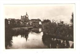CPA :57 - Moselle : Bouzonville : Eglise Vue De La Nied : Cours D´eau - église- Maisons - Peu Commune - France
