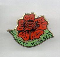 PINS PIN'S  SYNDICAT POLITIQUE LUTTE OUVRIERE FLEUR ROSE - Pin's