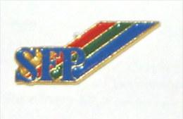 Pin's S.F.P.  SOCIETE FRANCAISE DE PRODUCTION - Otros