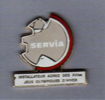 Pin´s  Sport, SERVIA  Installateur  Agréé  Des  XVI è  Jeux Olympiques D´ Hiver à  ALBERTVILLE  En  1992 - Jeux Olympiques