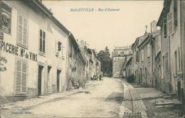 54 MALZEVILLE / Rue D'Eulmont / - Autres Communes