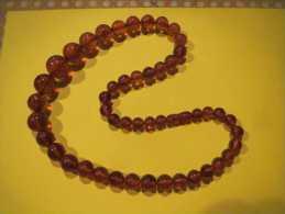 Collier En Ambre De Russie -64 Cm La Perle La Plus Grosse Fait 2 Cm - Colliers/Chaînes