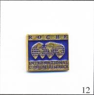 Pin´s - Santé - Labo Roche / International Clinical Research Avec Planisphère. Est. (I)ostens. Métal Peint. T145-12 - Medical