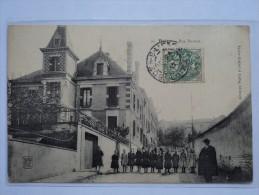 C P A  ANIMEE  RUE DAMON LES ECOLES  A BOEN  EN 1907 - Francia