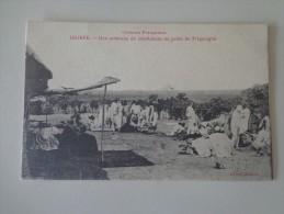 CPA GUINÉE CARAVANE DE CAOUTCHOUC AU POSTE DE FRIGUIAGBE - Guinea