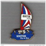 Pin's  Bateau  Voilier  KRITER  Avec  Boisson  KRITER  Brut  De  Brut  ( ARTHUS  BERTRAND ) - Arthus Bertrand