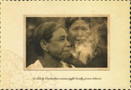 An Elderly Cambodian Woman Puffs Locally Grown Tobacco - Cambodja