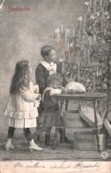 SOUHAITS TROIS ENFANTS DEVANT LE SAPIN DE NOEL CARTE PRECURSEUR CIRCULEE 1905 - Auguri - Feste