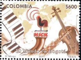 """Colombia 2011 ** YT1633  """"El Mundo En Bogotá"""" Radio HJCK. Gallo Cantando, Teclado, Saxofon, Contrabajo, Mapa Mundial - Colombie"""