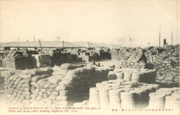 CHINA - DAIREN - DALIAN - SCENES ON DAIREN WHARVES - OPEN STORING GROUNDS WITH PILES OF BEANS - CAKES AWAITING SHIPMENT - China