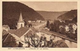 57 LUTZELBOURG  L'Eglise Et Le Canal - Otros Municipios