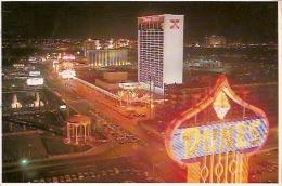 NEVADA-LAS VEGAS: POSTCARD THE FABULOUS LAS VEGAS STRIP AT NIGHT. DUNES HOTEL. GECKO.