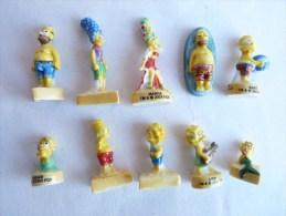 SERIE COMPLETE DE 10 FEVES SIMPSON a la plage socles jaunes 2005