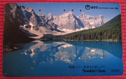 Telefonkarte Asien Japan NTT Smokin Clean See Berge Landschaft Telephone Card - Gebirgslandschaften