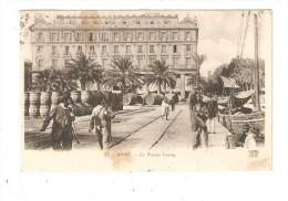 CPA : Bone : Le Palais Lecoq :Animation -  Bâtiment - Palmiers- Tonneaux - Quai - Bateaux - Alger