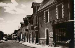 44-DERVAL-Rue De Nantes -(Magasin L´Economique,voiture,esse Nce,,,) - Derval
