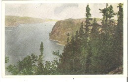 These Pine Clad Cliffs Of The Saguenay Cast Deep Shadows Over The River, Contributing To The Atmosphere Of Mystery - Saguenay