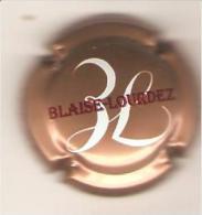 CAPSULE CHAMPAGNE BLAISE LOURDEZ DAMERY (rouge Et Blanc Sur Rose Metallisé ) - Champagne