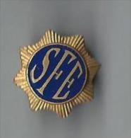 Insigne/Boutonni�re � molette/ SFE /Etoile � 8 branches/Origine � d�terminer /Bronze dor�/Vers 1925         D516