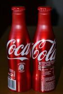 BOTELLA DE ALUMINIO DE ESPAÑA DE COCA-COLA (COKE) NUEVA SIN ABRIR Y CON LA BEBIDA - Botellas
