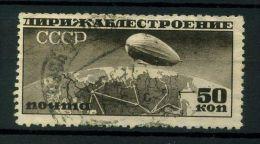 RUSSIE  ( AERIEN)   :  Y&T  N°  25    TIMBRE  OBLITERE ,  A  VOIR .