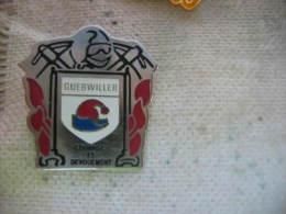 Pin´s Des Sapeurs Pompiers De La Ville De Guebwiller (Dépt 68). Courage Et Dévouement - Bomberos
