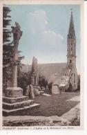 PLOZEVET (FINISTERE)  L'EGLISE ET LE MONUMENT AUX MORTS - Plozevet