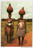 KENYA ..-- AFRIQUE ..-- Femmes Indigènes Portant Du Lait Au Marché . - Kenya