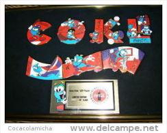 1 Coca Atlanta 1996 Izzy Puzzle  Pin Set im Rahmen.