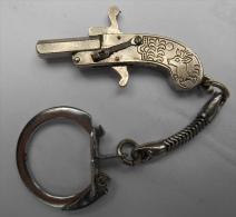 Pistolet à Broche Miniature Breloque - Armes Neutralisées