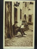 Dans un village d'Alsace Hansi au travail (texte au verso de sa main)