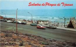 17715 Mexico, Tijuana, ocean, beach, cars driving bye