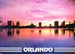 UNITED STATES OF AMERICA COLOUR PICTURE POST CARD - ORLANDO SKYLINE AT NIGHT, ORLANDO, FLORIDA