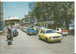 GABON - LIBREVILLE - Rue Du Centre , Très Animé Garage Mobil, Véhicules De Tourisme Année 60 , écrite, Non Timbrée - Pho - Gabón