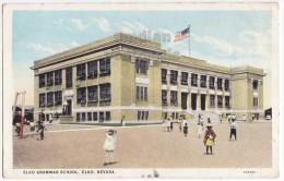 ELKO NEVADA~ GRAMMAR SCHOOL ~STUDENTS PLAY IN YARD ~ca1910s-20s vintage postcard - NV