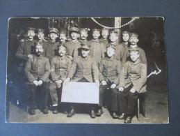 AK / Fotokarte Soldaten / Einheit. Munster Lager. Weihnachten 1916. Photogr. Schubert Munsterlager. - Personen