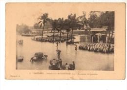 C P A--AFRIQUE    DAHOMEY-les Inondations De COTONOU 1925--transport Des Produits--voir 2 Scans - Dahomey