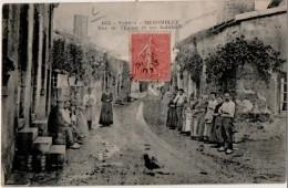 Menomblet Rue De L église Et Ses Habitants - France