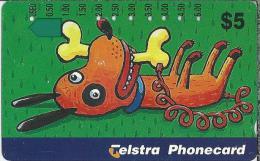 Telefoonkaart.- Australië. Telstra Phonecard - Cartoon, Hond Met Bot. Animal, Dog - Australië