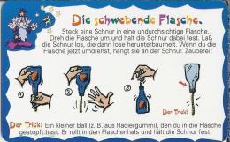 DE.- Telefonkarte 12 DM. Magic-Tric-Card Nr. 1. Die Schwebende Flasche. Der Trick. - Duitsland